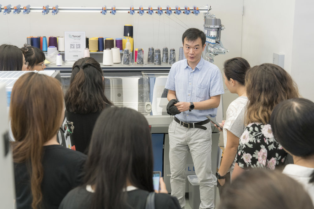 Lenzing leads a tour of their Hong Kong facility for educators and students