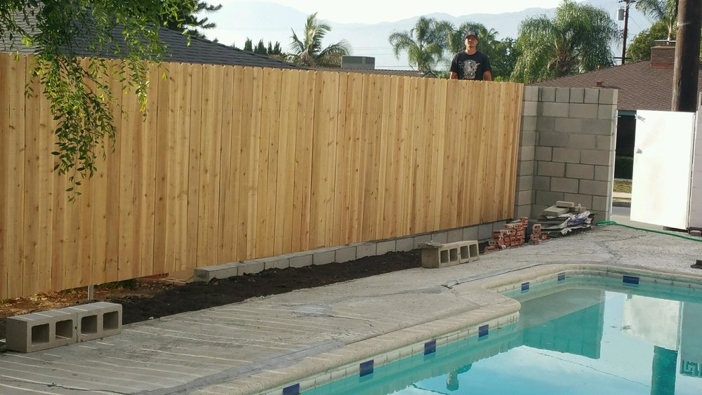 60 foot Cedar fence with new retaining wall