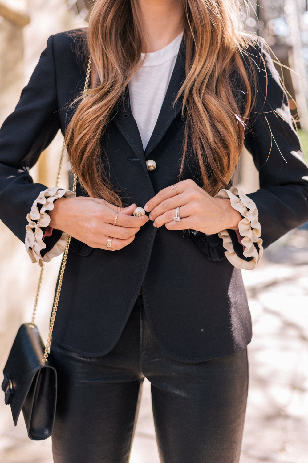 This is a perfect example of why I love her style.  She took an all black outfit and made it very feminine by styling this ruffle cuffed blazer, which is way more exciting than your average blazer.