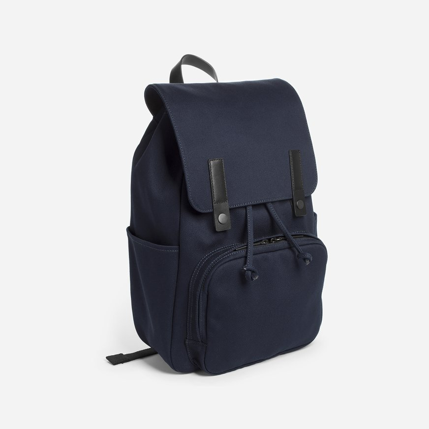 Everlane's The Modern Snap Backpack - Backpacks have made a huge resurgence in the past few years and so many guys are ditching crossbody messenger bags for their high school go to. This Everyone backpack is super sturdy and holds everything you could need. The leather touches give it a higher end feel without a huge price point. It comes in a variety of colors (Brett has the grey and loves it) and is perfect for guys of all ages!