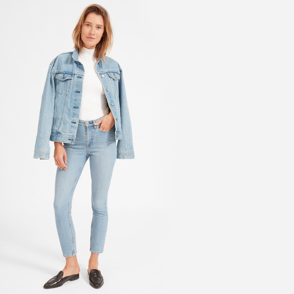 """Everlane The High-Rise Skinny Jean in Light Wash Blue (Ankle + Reg Length) - I own 3 pairs of jeans (yes, only three, you will read more about that tomorrow though) and 2 of those 3 are these jeans in the ankle and regular length. These jeans are the """"mom"""" jeans of my dreams, but don't give you the """"mom butt."""" The no stretch denim take an hour or two to break in, but you'll only need to wash them every few weeks because their lived-in give looks just as good as straight out of the wash. Trust me, you NEED these in your closet ASAP."""