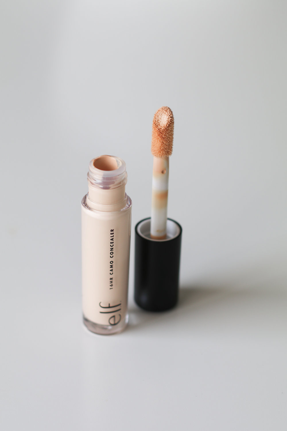 "e.l.f. 16HR Camo Concealer - $5 - What it claims? ""The highly pigmented formula is lightweight, dries matte and won't settle into fine lines or creases.""Pros: Price! At $5, this concealer is a steal! Modeled after Shape Tape, the concealer also has a large doe-foot applicator for large area concealing. I agree that it is lightweight and highly pigmented. If you are looking for a cheaper alternative to Shape Tape, this really is your best choice and it's why I gave it the same rating.Cons: Shade selection is small and a little off. I had to order 3 shades before finding my match (Light Sand). The lighter shades are are a lot lighter in person. But, some reviewers said they noticed oxidation, which means it got darker the longer they wore it, but I did not experience that. Blending with a BeautyBlender did not work well at all. The sponge picked up the product and left a splotchy mess. Fingers are the best option for blending. Like Shape Tape I did find it dry before and after setting with powder.Rating: 3/5Parting thoughts: This is a great Shape Tape dupe with the small caveats of harder shade matching and blending problems, but I could forgive that for the awesome price!"