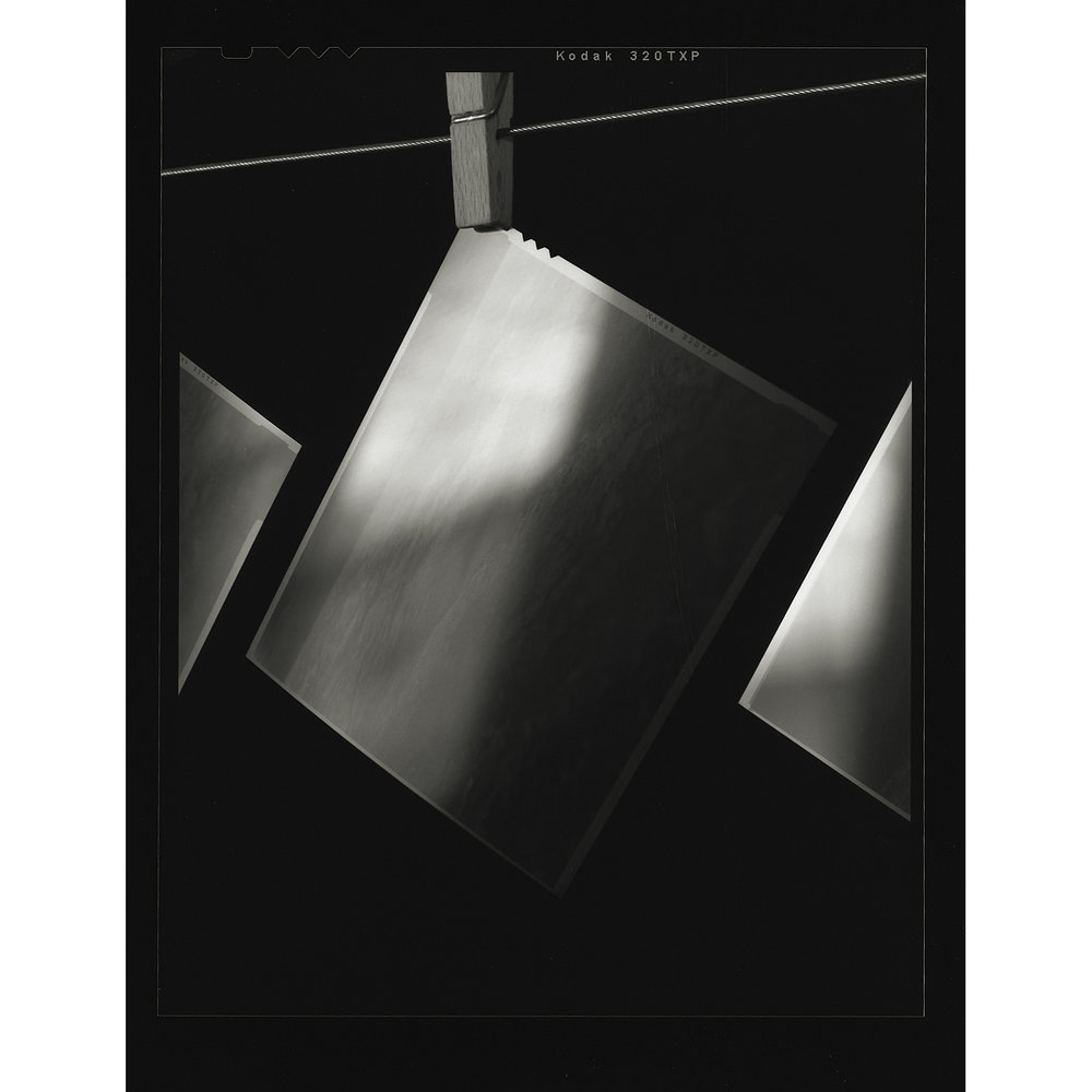 4x5 Gelatin Silver Contact Print of 4x5 negatives hanging to dry.