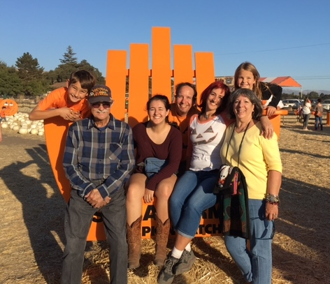 The whole Fam, my folks included, fit in Spina Farm's giant chair!