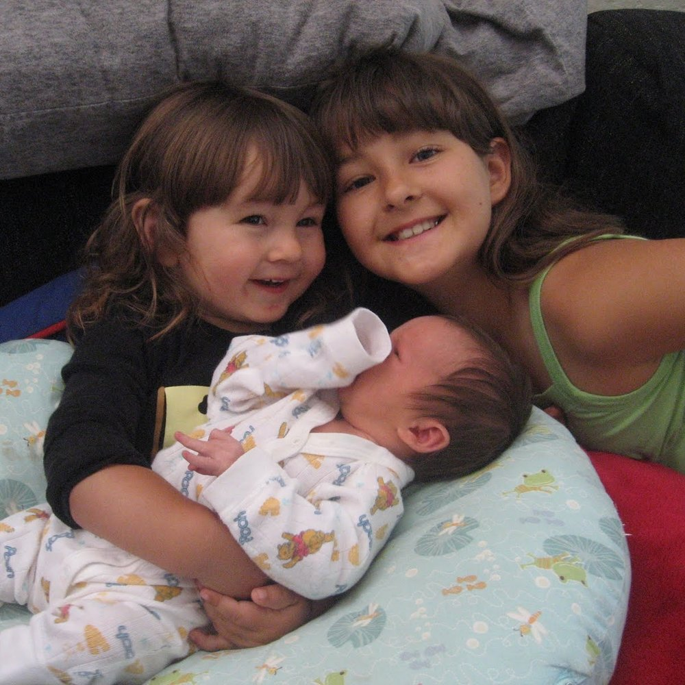 Maceo and Jeannessa love on their new sister