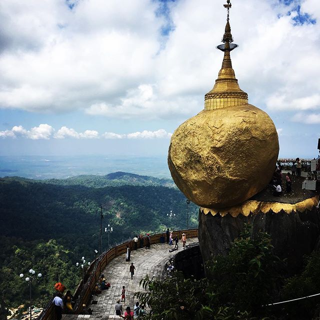 If you look closely you'll see a monk leaning by the rock...dropped his iPhone under it and trying to figure out how to get it...haha just kidding. It's said golden rock is held up by one of buddhas hairs. #goldenrock #myanmar