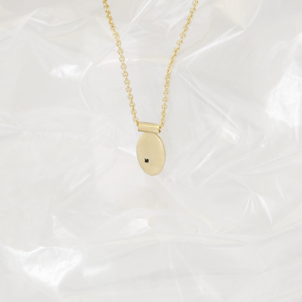 Birdchi Pendant | 18kt gold plated sterling silver with black Spinel.