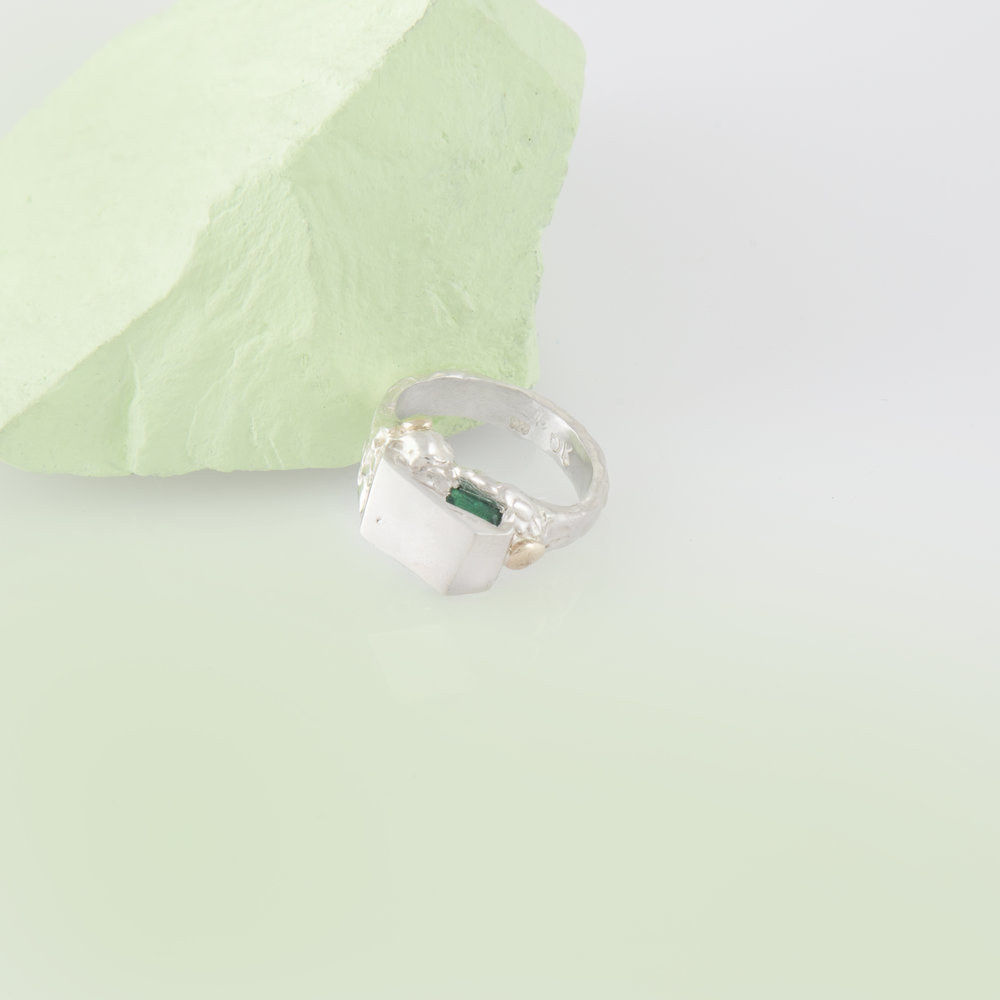 Arctic ring for Anton | Sterling silver with hydrothermal emerald and 9ct yellow gold granules.
