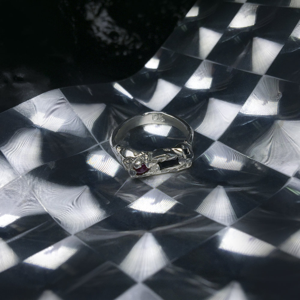 Ky Ring | Ruby cabachon and black sapphire baguette.