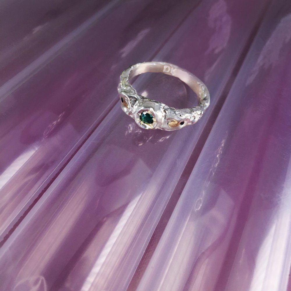 Jess Birthday Ring | Green sapphire with gold granules and black sapphire.
