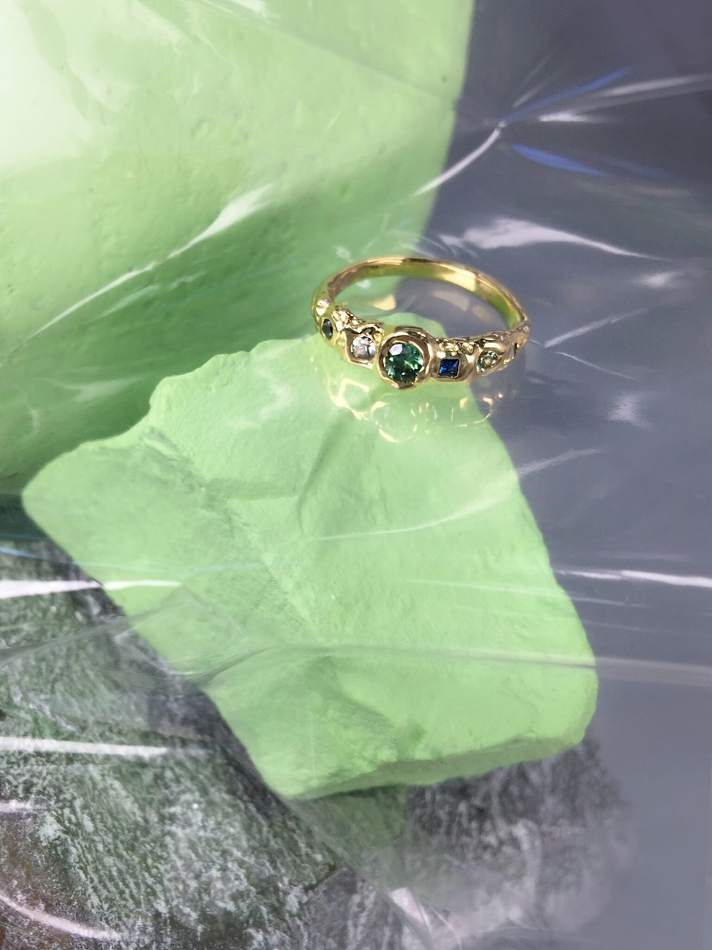Mariam & Mason Engagement Ring | 18kt yellow gold with Sapphires and emerald.