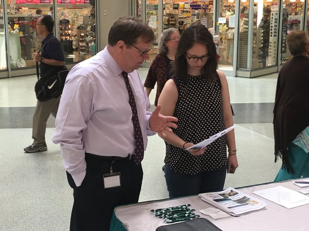 Dauphin County Planning Coordinator Jerry Duke speaks to a visitor about the county comprehensive plan at a 4/12/17 outreach event at Strawberry Square in downtown Harrisburg.