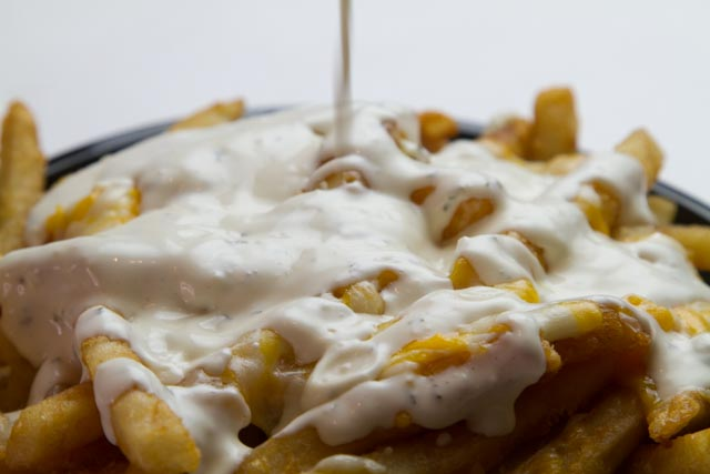 Taza fries with cheese. You haven't had anything like it!