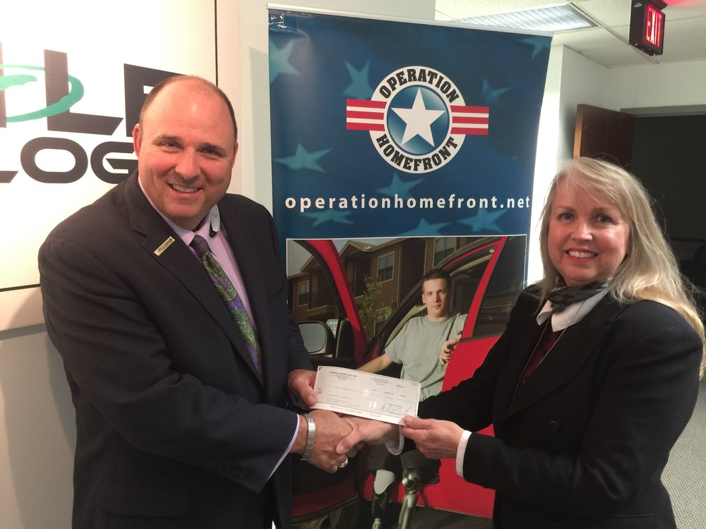Wes Hester, CEO, presents a $10,000 check to Vivian Dietrich, Regional Director, Operation Homefront.