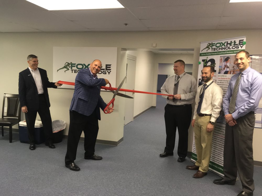 Wes Hester, CEO, cuts the ribbon during the opening ceremony for the new Innovation Lab.