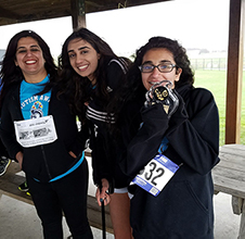 Monika Segal, and her daughters Neha and Simran, finish the 5k.