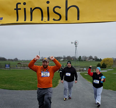 Tom Kershner, Jeff Bert and Dee Rider are happy to cross the finish line.