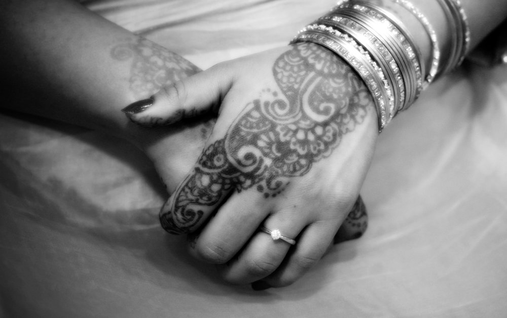 Bridal Mehndi worn at an Asian wedding. This with the jewellery makes for an intriguing close-up.