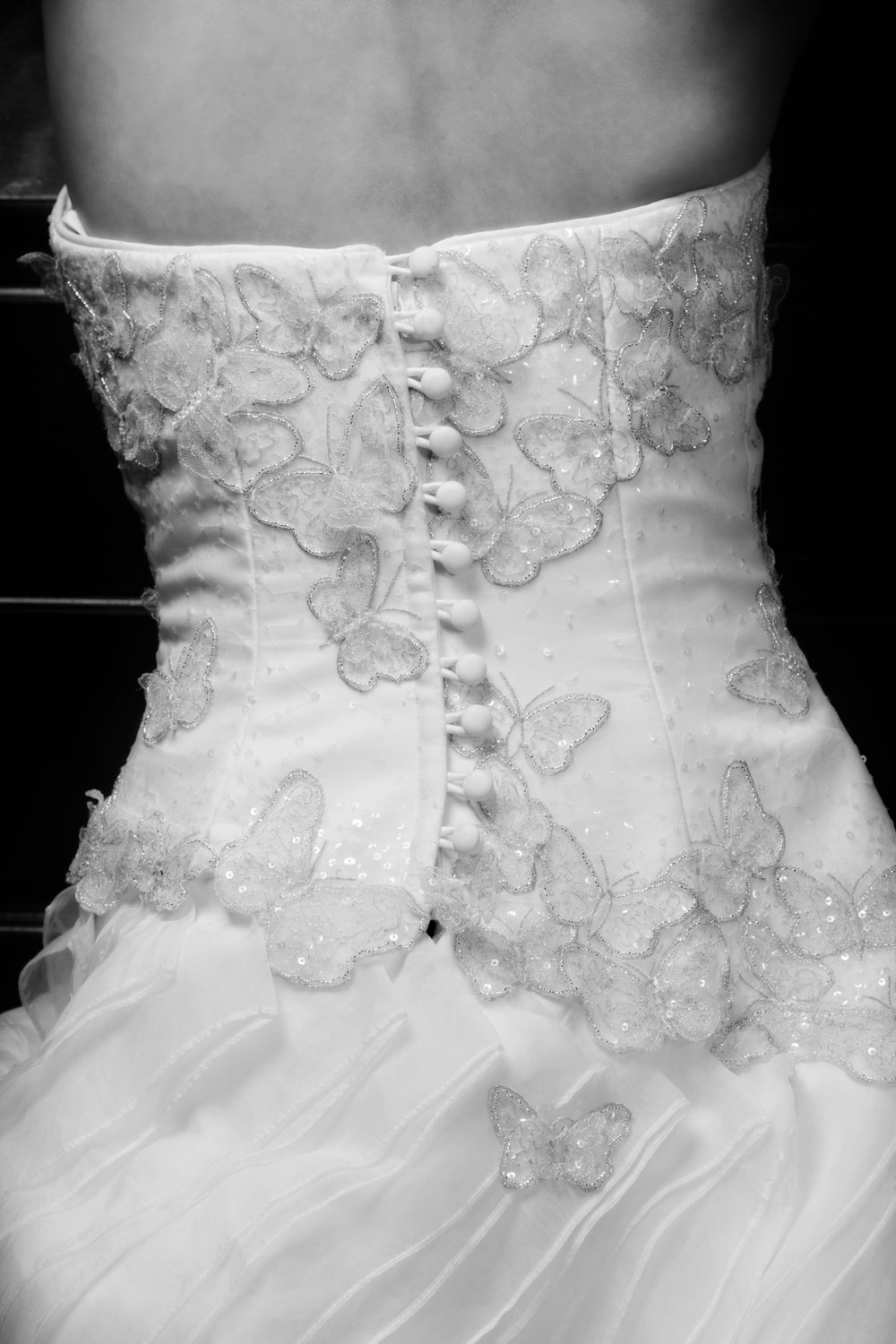 Details on the back of the bride's dress. A picture almost guaranteed to be featured in the wedding album.