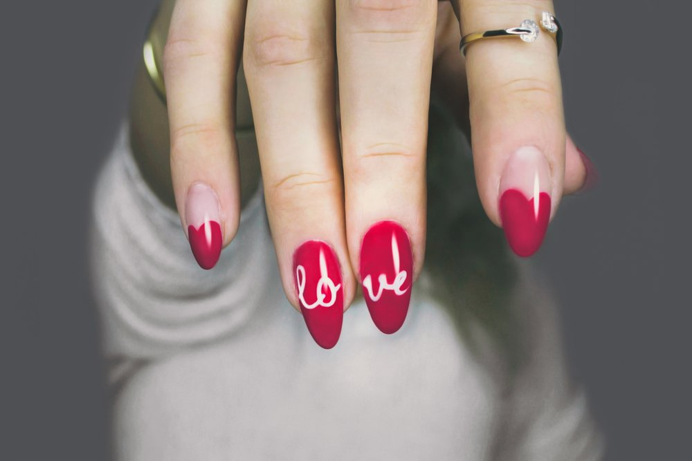 Picture of manicured nails that spells love.