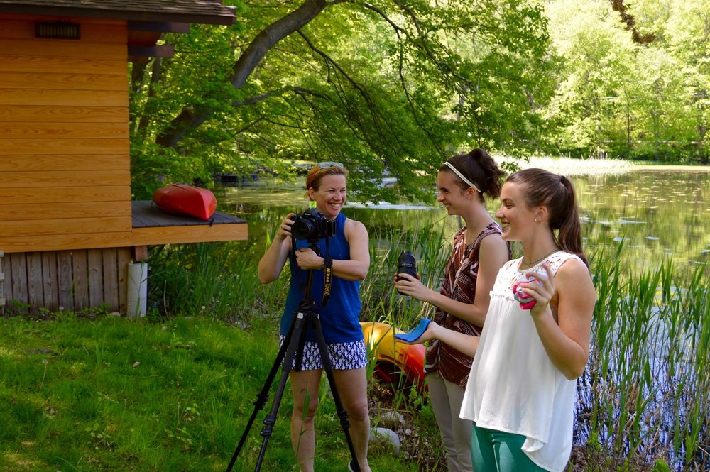 Jane Beiles, Annalee Greenspon, Abigail Deery helping photograph a home on a lake at a New York Times shoot