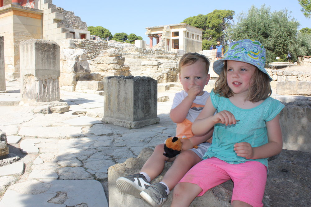 Cute and cranky kids amidst the ruins