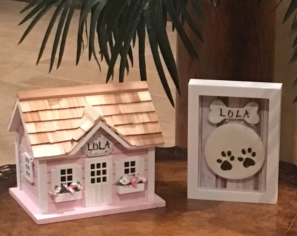 Available Urn Colors: Pink as shown, White, Blue, Green, Yellow, Gray (Traditional wooden urns also available) Paw print and our signature little house is an additional cost.