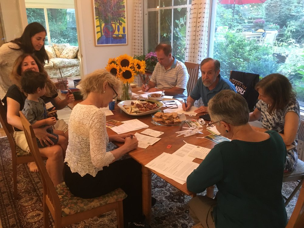 Sister District Massachusetts write postcards to get out the vote for John Bell.