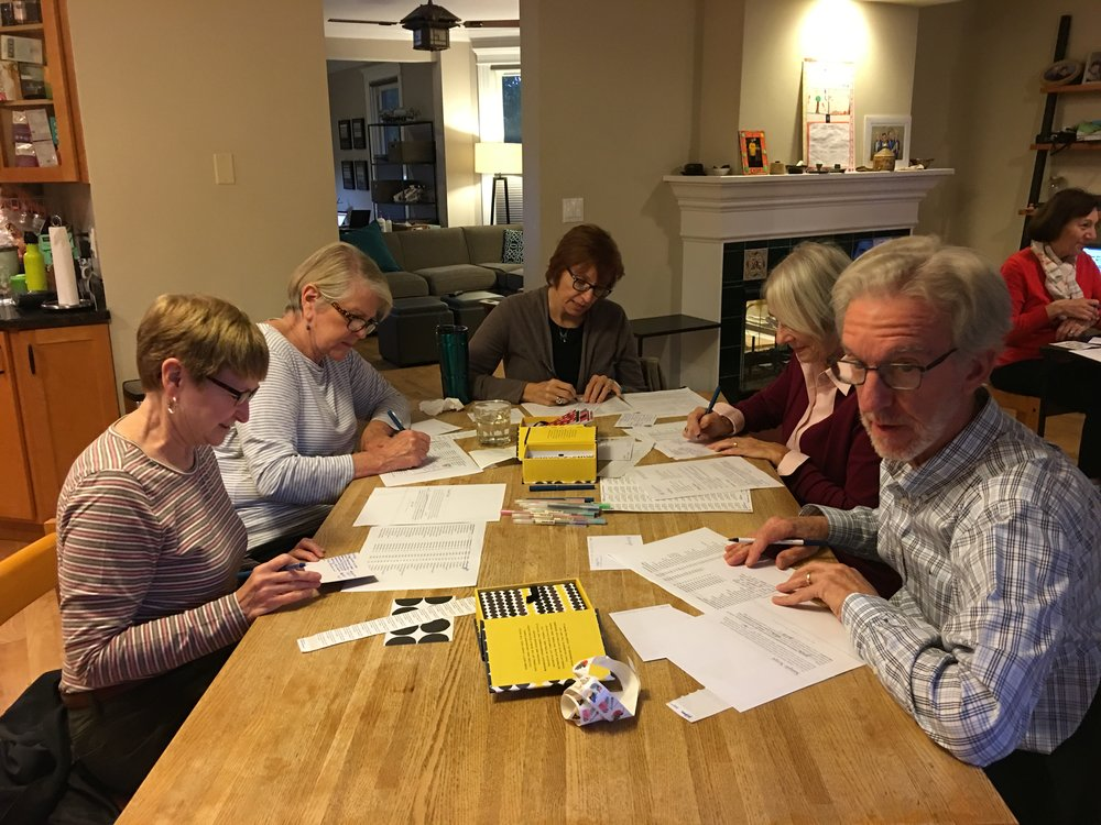 Volunteers in Chicago write postcards and make calls for Chris.
