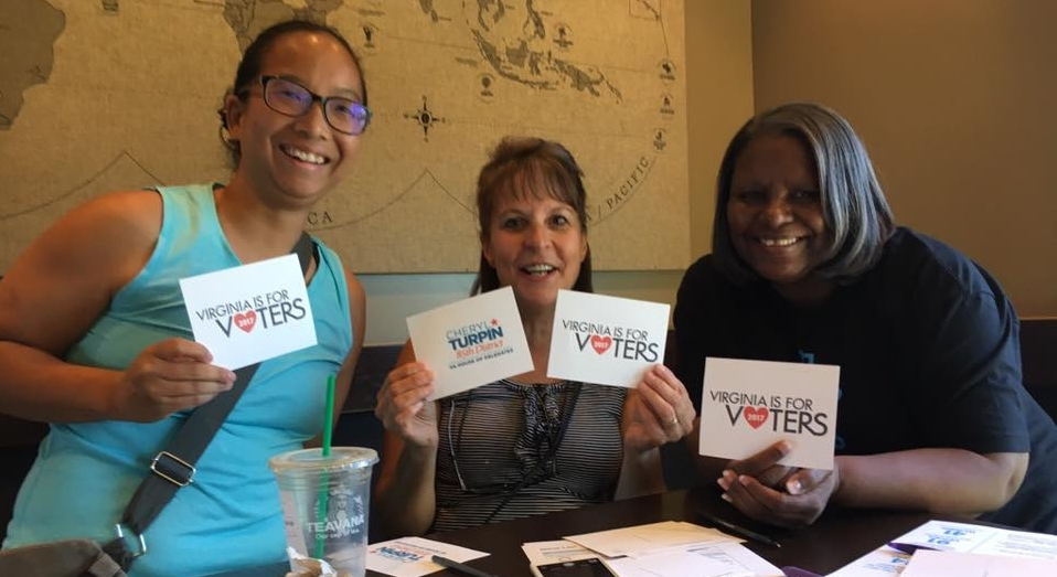 Members of the Sacramento team write postcards to voters.