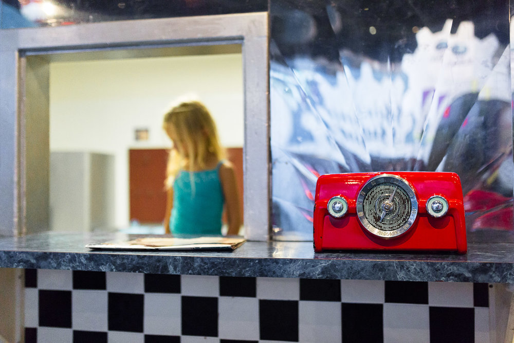 red retro radio and girl at children's diner