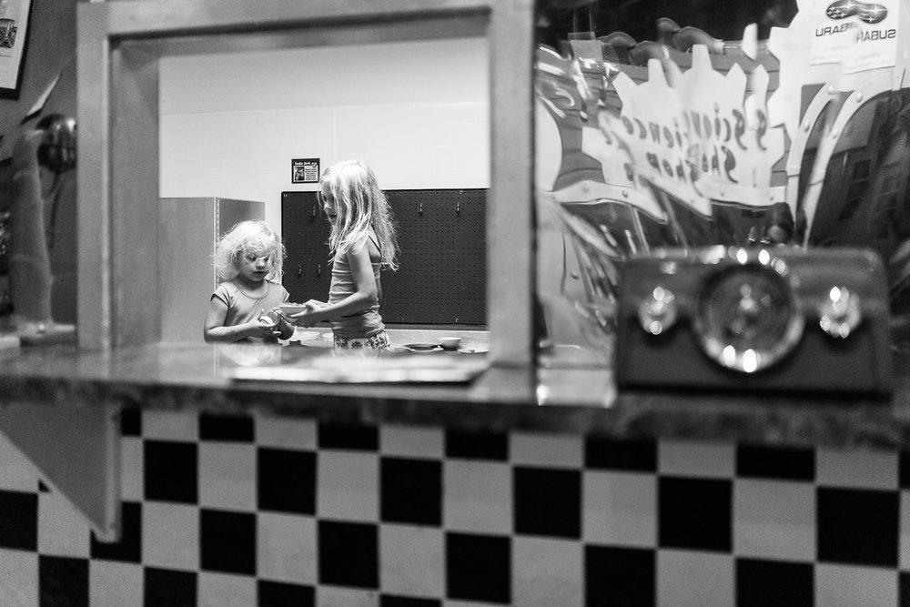 girls playing in children's diner