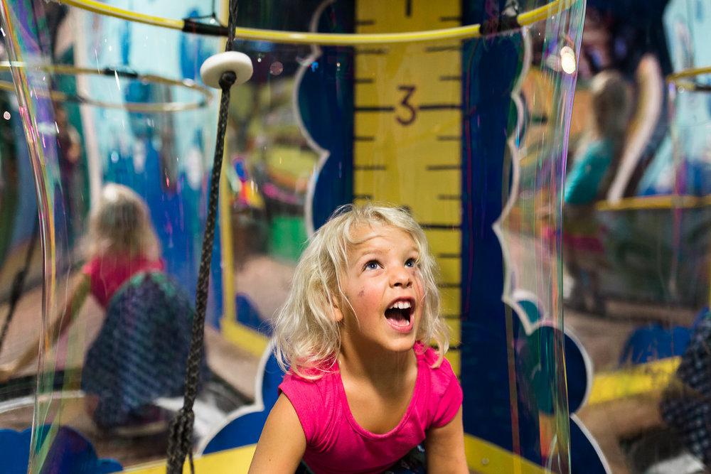 little girl inside giant bubble