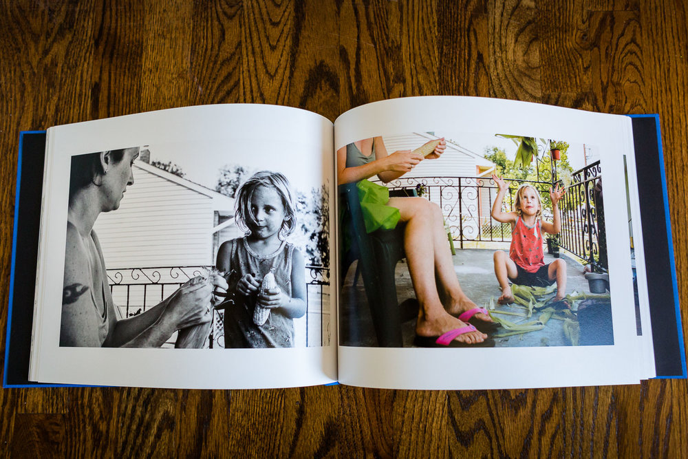 Two-page spread of album or photo book displaying color and black and white family photos.