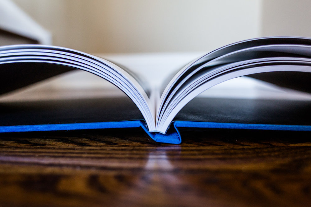 Close-up of high end album spine with blue linen cover