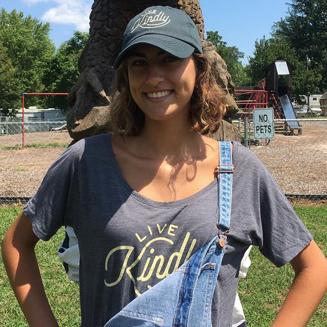 Get out and show your kindness. This fan is wearing our asphalt slouchy tee and hunter green hat.  Shop at https://www.livekindly.com/store/ #bekind #spreadkindness #tee #hat #kindon