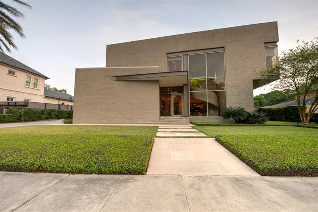 1324 Oriole St.  - This luxe Lee Ledbetter-designed, steel framed contemporary is seriously swanky. Hailing from the bird streets along Lake Pontchartrain, my favorite feature is the paneled wall in the living space with gallery shelving. I may steal that idea for myself.