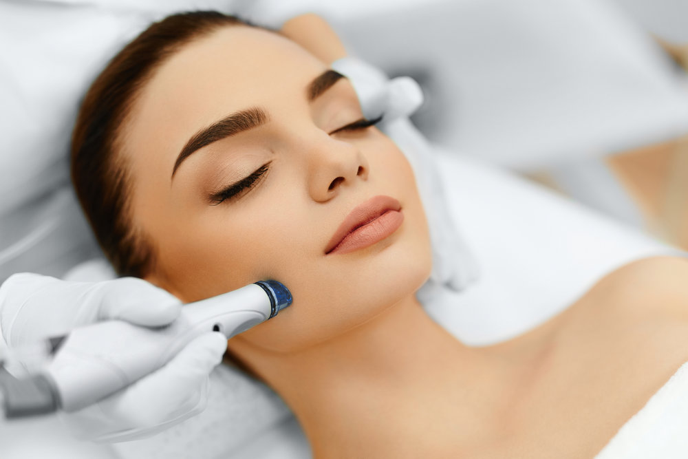 face-skin-care-facial-hydro-microdermabrasion-peeling-treatment-63738624.jpg