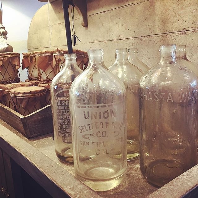"Antique seltzer bottles....look close you can see the words ""Shasta water""....super cool😬 Available in the shop $24each😙#antiques #modernfarmhouse#fixerupperstyle #countryliving #shoplocal #interiordesign #interiordecor #furniture#accessories #blackdoorinteriors"