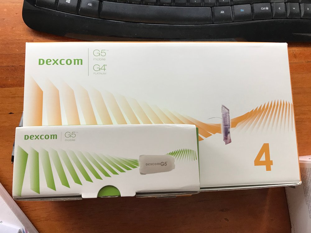 The smaller box contains the Dexcom transmitter. The larger box contains the sets.