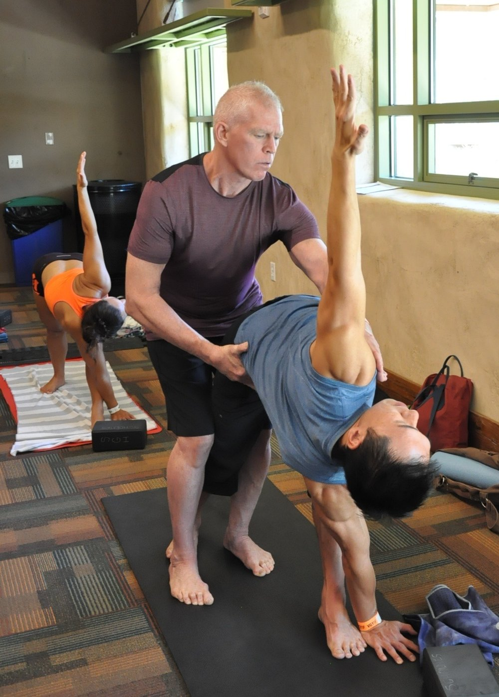 Adjusting alignment at the Tadasana Yoga Festival.