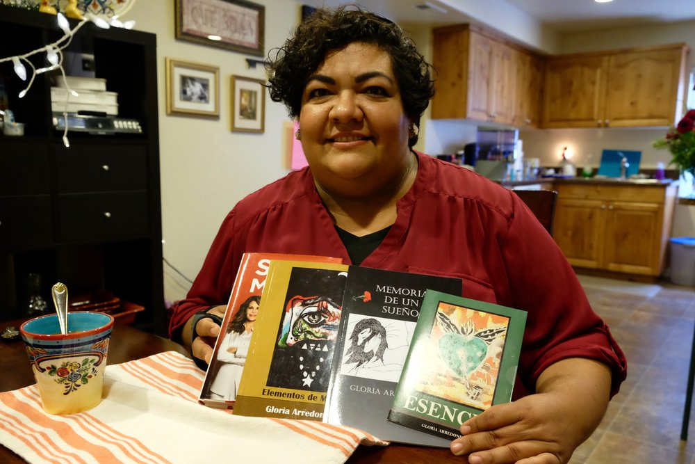 Writer Gloria Arredondo holds some of her published works. (Andrea Smardon)