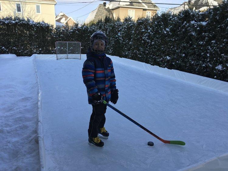Kid skating on EZ ICE Backyard Hockey Rink.
