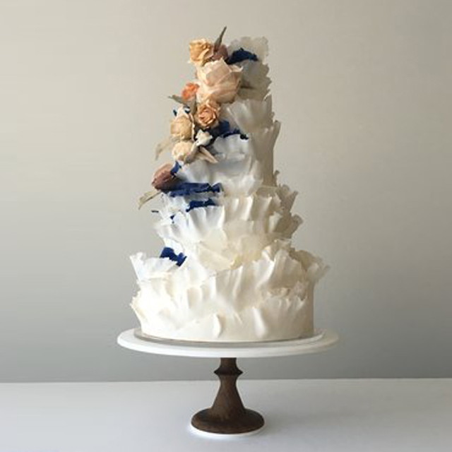 torn paper white navy coral wedding cake