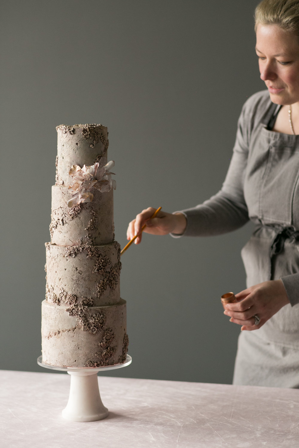 A NEW VISION FOR CAKE DESIGN - An Online Course with If I Madehttp://www.ifimade.com/jasmine-rae/course-homeThis course is about learning principles that may help YOU find YOU, your own voice, a voice you may want to share with the world in the robust form of a thriving business. This course isn't about a formula, isn't about tips and tricks, or how to be me. I'm extremely proud of the class we have created for you, because it was about using myself as an example of a journey. Though this online workshop is rooted in practicality, technique, and lessons, it's also beautiful, and most importantly, it was about sharing a perspective, principles, and an approach to myself as an artist. My hope is that you'd be able to do the same and end up with something uniquely YOU. This course was designed with the hope that something will resonate for you and be immediately applicable to your life and business.In the first part of the course, The Business Behind Cake Design, I'll walk you through some things I've learned about owning and operating my own business, including how I started Jasmine Rae Cakes, how I found and (continue to) develop my voice as an artist, my philosophy on pricing and ways I believe the wedding industry needs to change, and how I manage my team and client logistics.In the second part of the course, The Art of Cake Design, I'll teach you numerous advanced decorating techniques that are essential to some of my signature cake designs. Starting with some familiar (and unfamiliar) tools and materials, I demonstrate how I approach rough stone/marble/granite, bas relief, metallic finishes, and how to age those textures. This is also the first time I am teaching how to make my rice paper flowers.For me, techniques and tips are simply an ACCESS to skill-building. It IS helpful for growing artistically, and I do want to show you what I've learned so you can expand your repertoire...but I believe the MAIN function of teaching, of sharing MY self, is to be so clear in showing you MY perspective, that you feel more clear about your own, about YOUR self. Working on your personal expression as a cake artist will change your business. Instead of continuing to make yet another popular Pinterist pin cake, you'll be making work that is unique and inspired...professionally.It is a process, and it takes time, ripening, and it takes support.