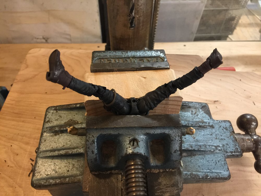 Drill a hole to mount the figure to a stick