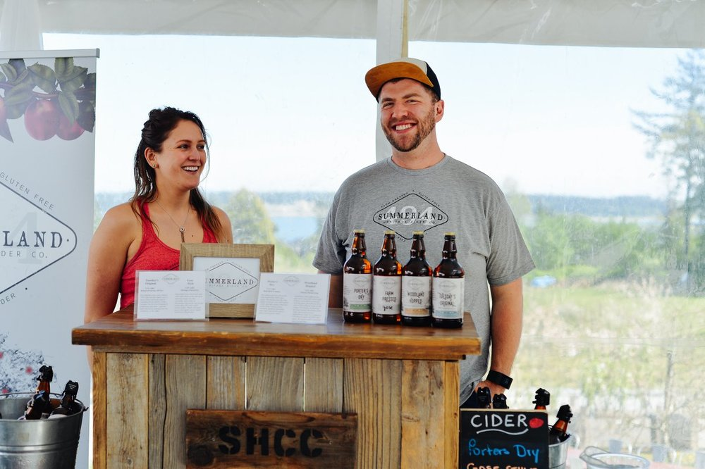 Lauren and Summerland Cider's friend Cam pouring at last year's event.