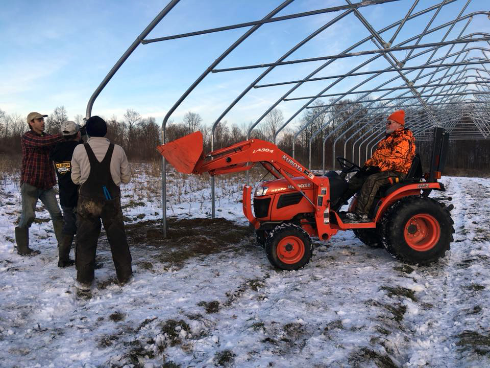 Grandpa Gary and his tractor, and several friends helped with our big high tunnel project in December.
