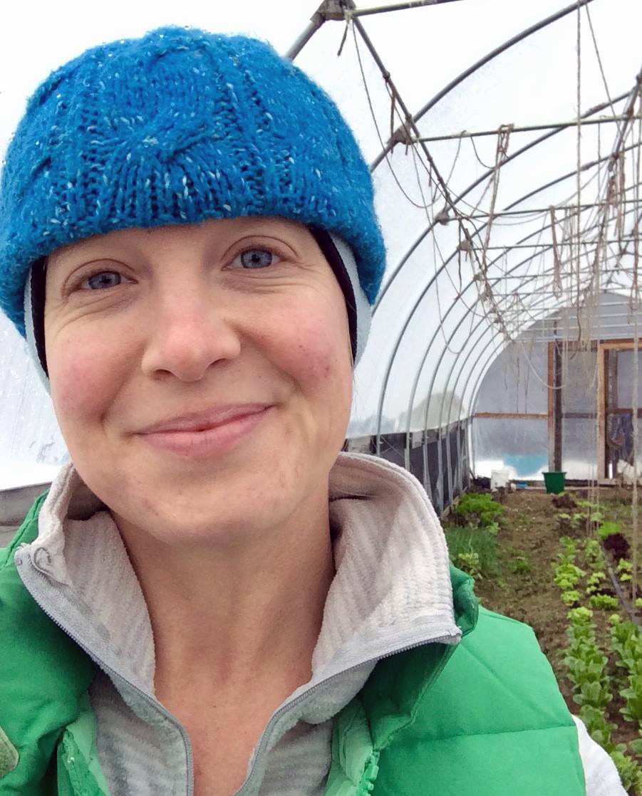 That's me, harvesting lettuce heads in the little high tunnel this winter.