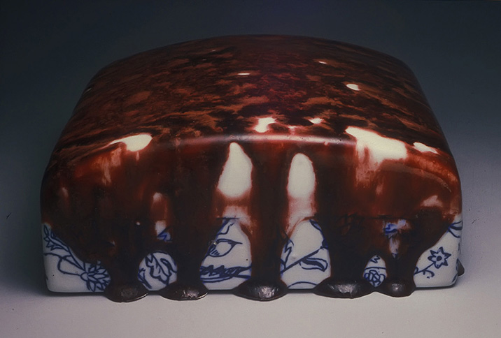 <i>A Bleeding Ox </i>, porcelain, inlay, c/10 red. fired, 1995